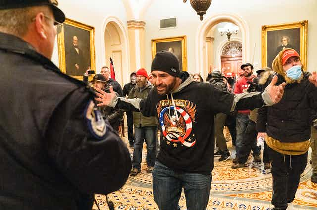 Protesters mill about the area outside of the U.S. Senate Chamber.