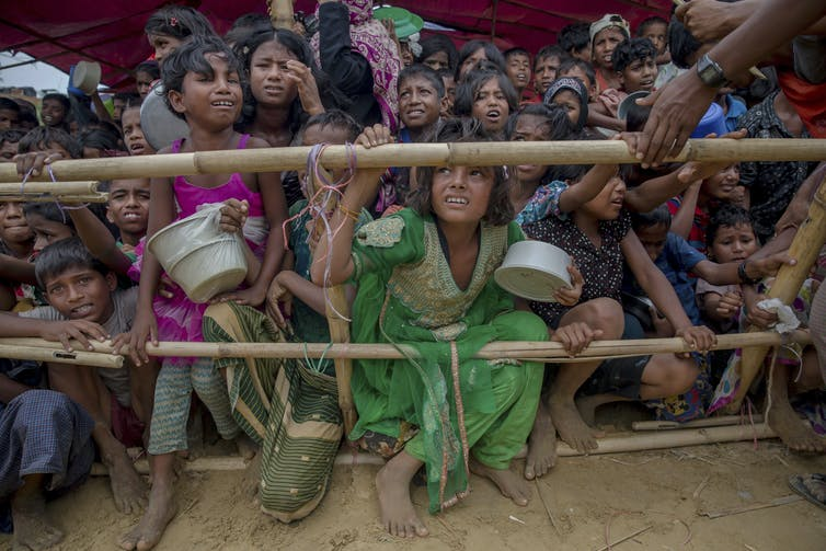 Rohingya children wait for food to be distributed by Turkish aid workers at the Thaingkhali refugee camp in Bangladesh in October 2017.