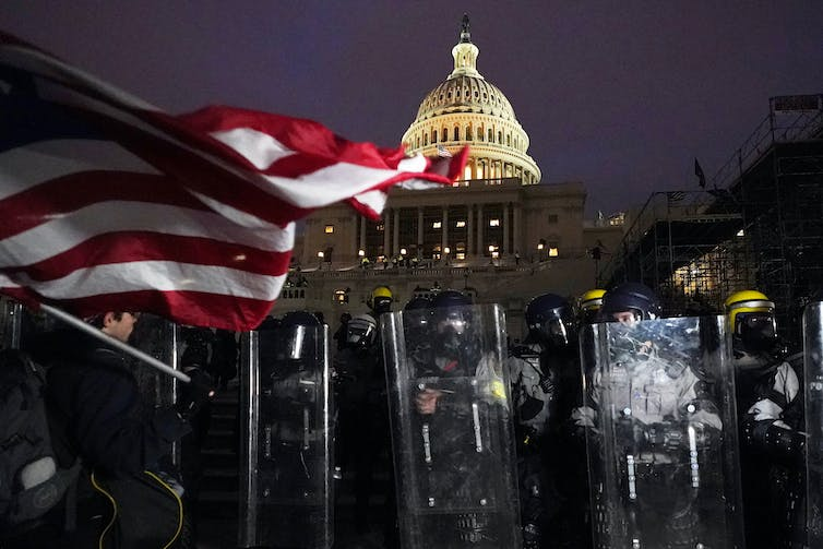 Guards surround the US Capitol after it's locked down from rioters.
