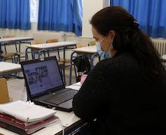 A teacher teaching online.