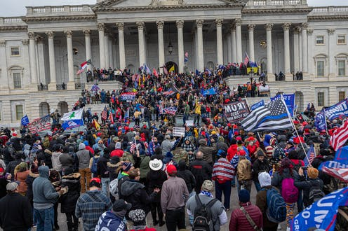 image shows a crowd of Trump supporters on the steps of Capitol Hill on January 6, 2020.