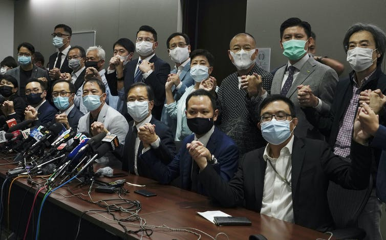 Hong Kong lawmakers resigning.