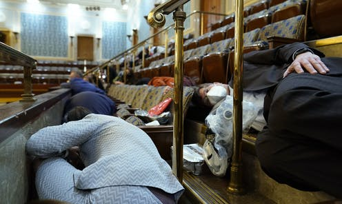 Lawmakers duck and cover in the U.S. Capitol.