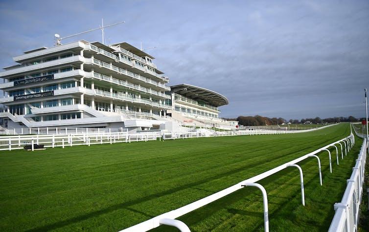 Building overlooking grass horseracing course