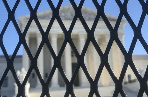 Fencing outside the U.S. Supreme Court on Capitol Hill.