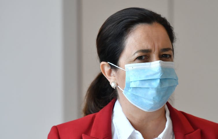 Queensland Premier Annastacia Palaszczuk wearing a surgical mask