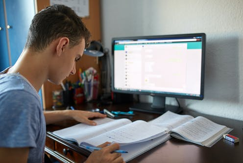 Teenager working in front of computer