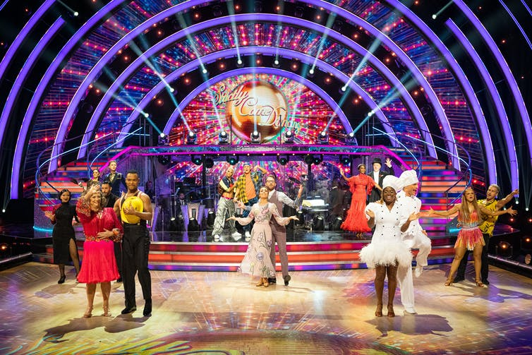 Ballroom contestants pose on Strictly Come Dancing dancefloor