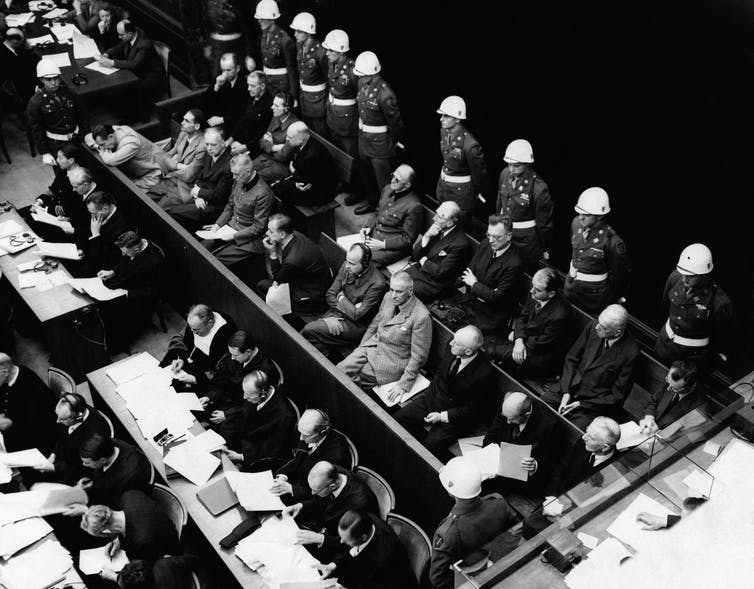 German war crimes defendants sitting in a courtroom at the Nuremberg trials.