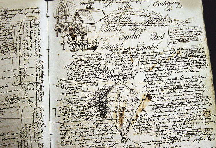 A page covered in Dostoevsky's handwritten script, doodles and drawings.