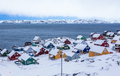 Colourful houses along a fiord outside of Nuuk, Greenland.