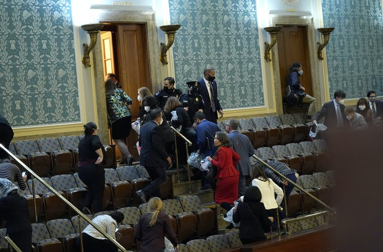 Members of Congress were forced to evacuate the House Chambers to evade protesters.