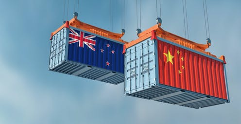 Shipping container with NZ and Chines flags painted on sides