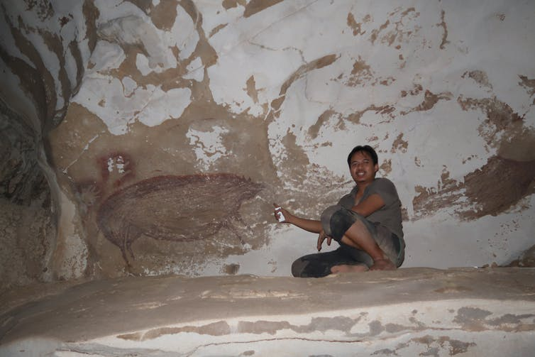 Inside the cave is a painting of warty pigs.