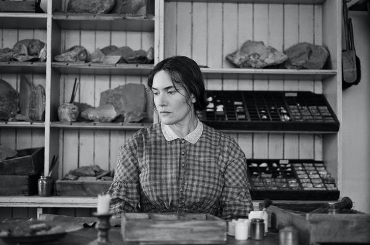 Black and white photo of Winslet as Anning.