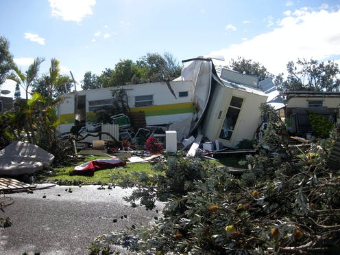 Caravans are seen tipped over by storms.