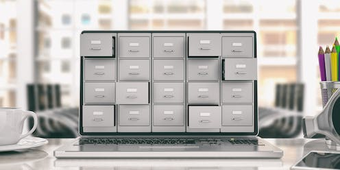 Laptop screen with filing cabinets poking out
