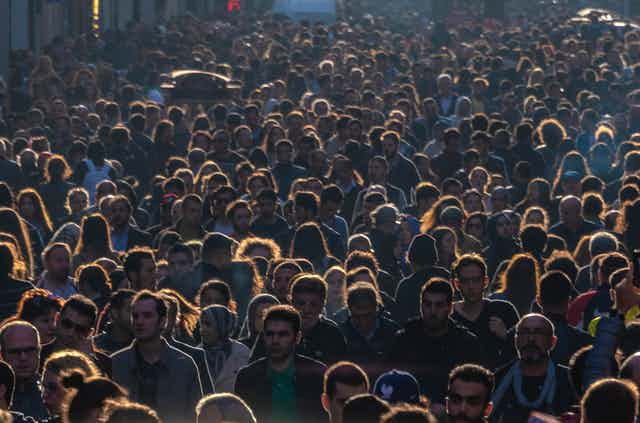 An image of many people crowded close together.