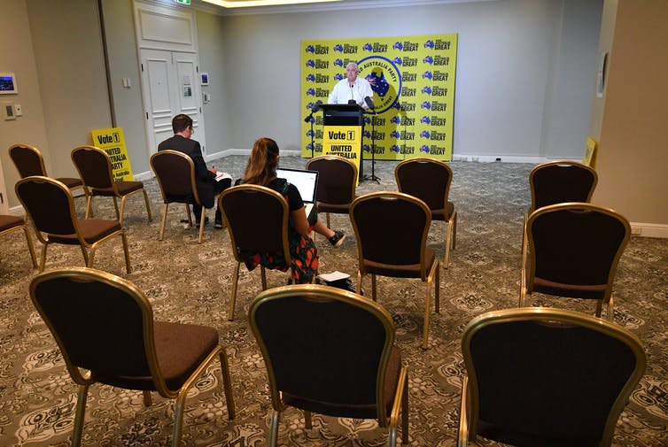 Clive Palmer speaks to a near-empty press conference.