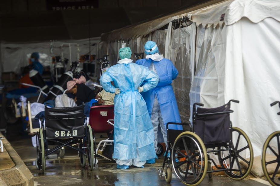 Patients being treated in makeshift tents.