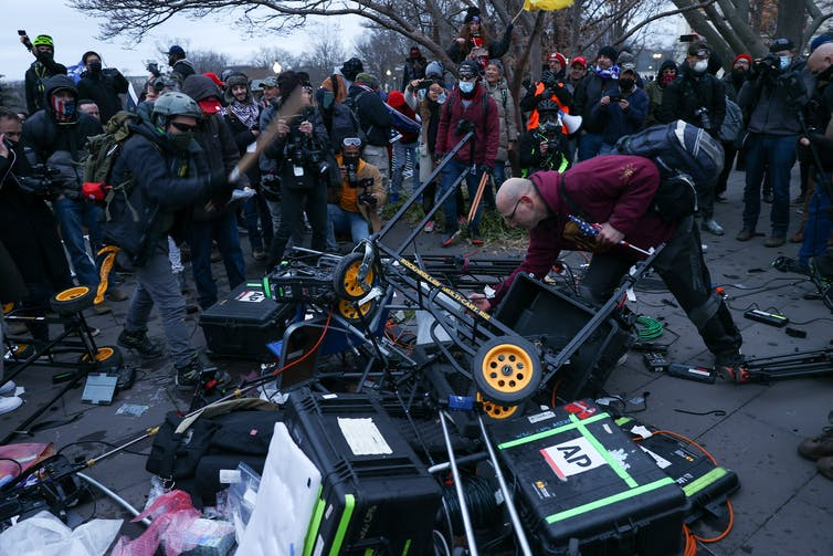 A pile of damaged news equipment, including cameras, at the Capitol riot.
