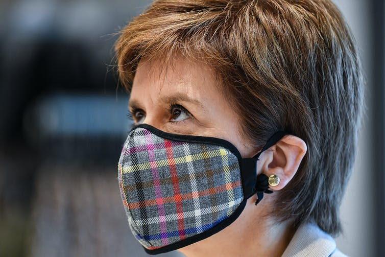 Nicola Sturgeon wearing a tartan mask.