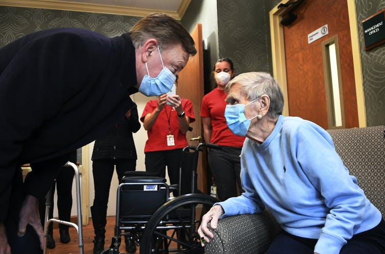 Jeanne Peters, 95, received the first COVID-19 vaccination at a nursing home on Dec. 18, 2020, in West Hartford, Conn.