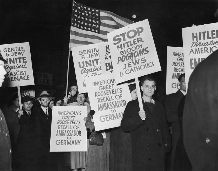 A demonstration near the German ocean liner SS Bremen in New York, after Hugh Wilson, the American ambassador to Germany was recalled in the wake of Kristallnacht.