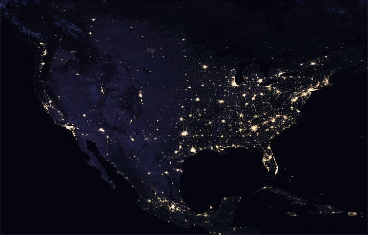 Satellite image of U.S. at night with cities brightly lit