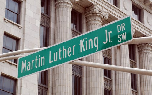 Street sign reading Martin Luther King, Jr. Dr SW in front of columned building