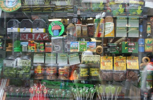 A store window with colourful cannabis packaging on display.