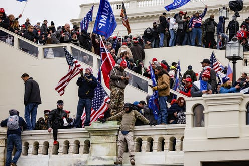 Rioters mass on the US Capitol steps