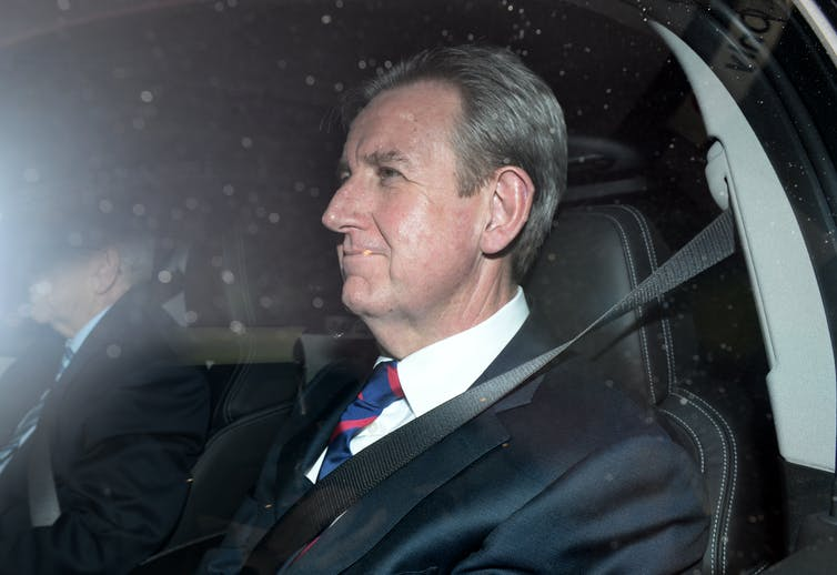 Former NSW premier Barry O'Farrell in the back seat of a car.