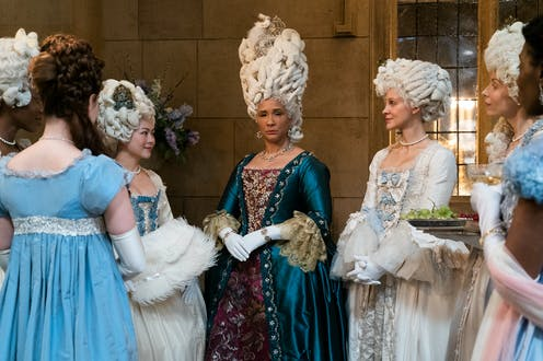 Women in Regency period constumes.