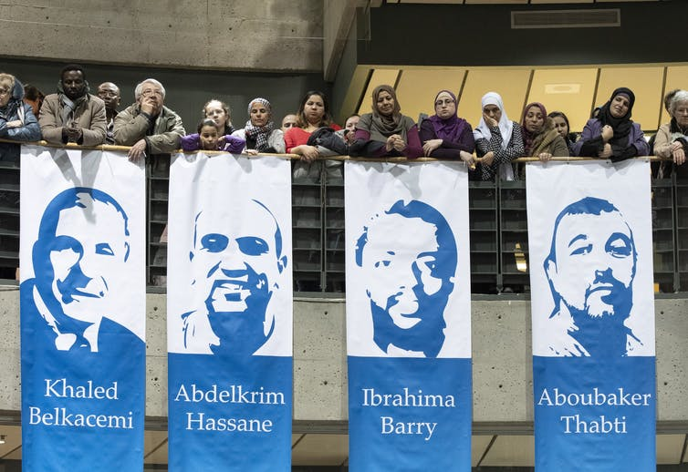 Four large banners depicting some of the victims of the mosque shooting.