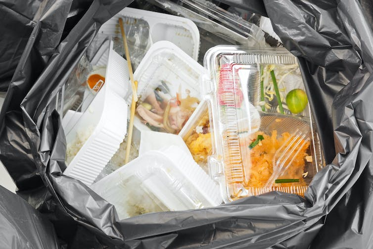 Food packaging waste in a bin