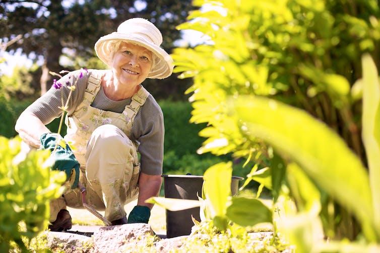 An older woman gardening