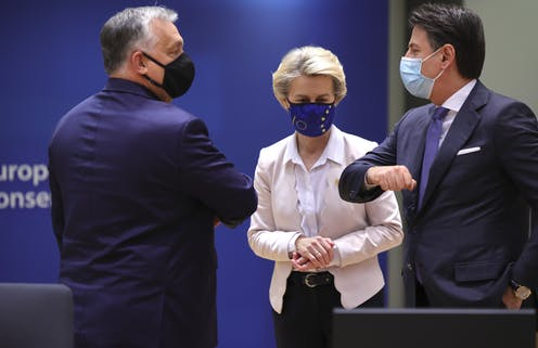 Hungary's Viktor Orban greets Italian prime minister Giuseppe Conte as Commission president Ursula von der Leyen looks on