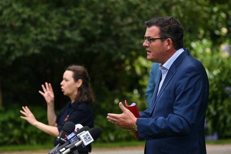 Dan Andrews and interpreter at a press conference