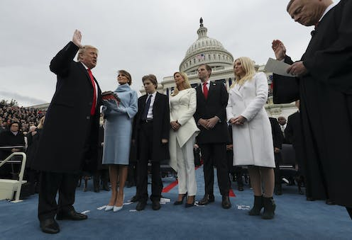 Trump taking the oath of office in 2017, with his family present.