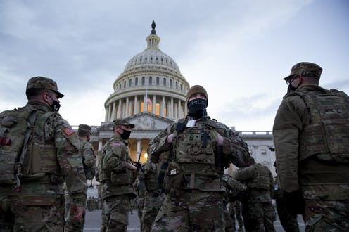 US military personnel guard the Capitol Building in Washington