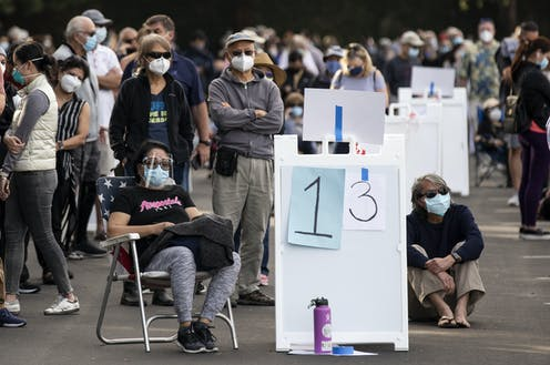 People queuing up to get vaccinated in California.