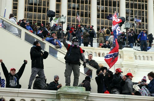 Rioters gather on the steps of the U.S. Capitol Jan. 6