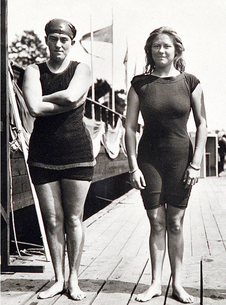 Two women in heavy bathing suits.