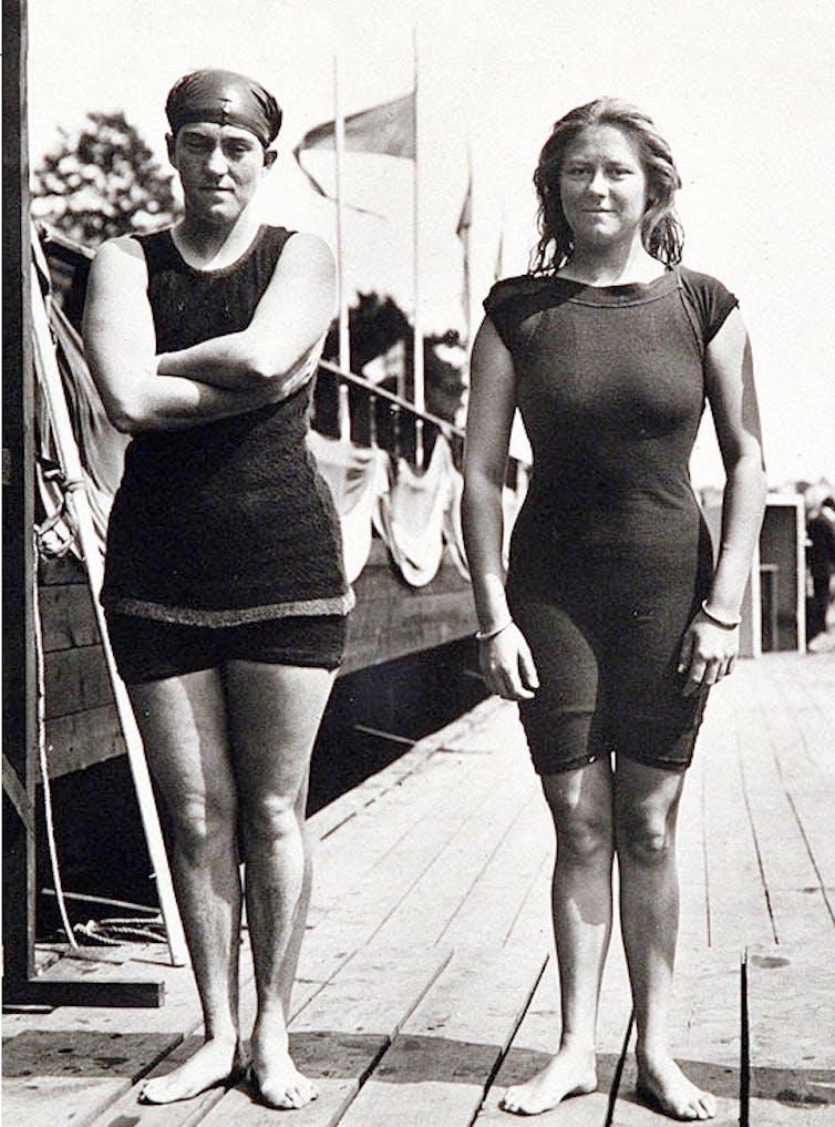 Two women in heavy bathing suits.
