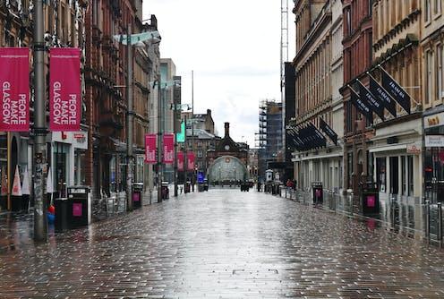 A wet and empty Buchanan Street in Glasgow during lockdown.