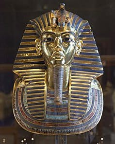 The gold and blue funerary mask of the ancient Egyptian pharaoh Tutankhamun.