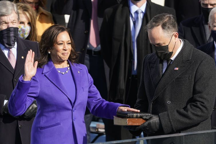 Kamala Harris is sworn in on a Bible