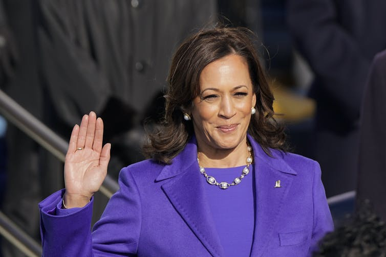 Kamala Harris raises her right hand while being sworn in as Vice President.