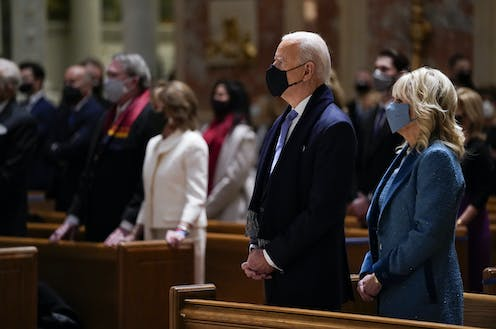 President-elect Joe Biden and his wife Jill Biden attend Mass at the Cathedral of St. Matthew the Apostle during Inauguration Day ceremonies Wednesday, Jan. 20, 2021, in Washington.